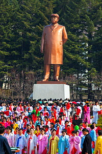 Women wearing colourful traditional dress for celebrations on the 100th anniversary of the birth of President Kim IL Sung, Pyongshong, satellite city outside of Pyongyang, Democratic Peoples' Republic...  -  Gavin Hellier