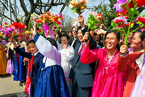 Women in traditional dress during street celebrations on the 100th anniversary of the birth of President Kim IL Sung, Pyongyang, Democratic Peoples' Republic of Korea (DPRK) North Korea, 15 April 2012  -  Gavin Hellier