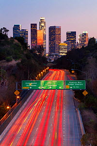 Pasadena Freeway, CA Highway 110, at dusk with light trails from cars, leading into downtown Los Angeles, California, USA, June 2011 - Gavin Hellier