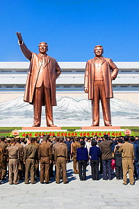 Mansudae Grand Monument- people in front of giant statues of former Presidents Kim Il-Sung and Kim Jong Il, Mansudae Assembly Hall on Mansu Hill, Pyongyang, Democratic Peoples' Republic of Korea (DPRK... - Gavin Hellier