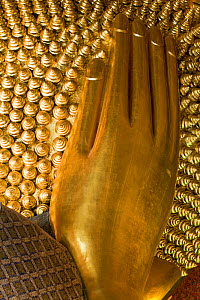 Wat Pho, Reclining Buddha, 46 metres long made of brick plaster and Gold leaf, hand detail.  The soles of the feet are inlaid with 108 lakshana, or auspicious images that identify the true Buddha craf...  -  Gavin Hellier