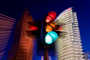 Traffic lights and office buildings illuminated at dusk, part of new urban development, modern architecture skyscrapers in Potsdamer Platz, Berlin, Germany, 2007.  As was the case in much of Berlin,...  -  Gavin Hellier