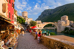 Cobbled street lined with colourful houses known as Kujundziluk, one of the oldest streets in Mostar leading to the Old Bridge, Old Town, Mostar, Herzegovina, Bosnia and Herzegovina, Balkans, 2007  -  Gavin Hellier