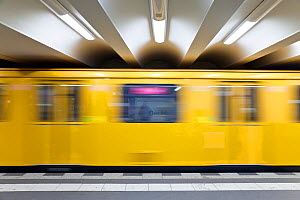 Moving train pulling into the station of modern subway station, Berlin, Germany 2009  -  Gavin Hellier
