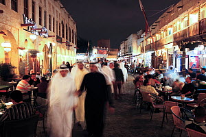 The restored Souq Waqif with mud rendered shops and exposed timber beams at night, Doha, Qatar, Arabian Peninsula, 2011. No release available.  -  Gavin Hellier