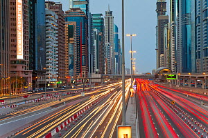Sheikh Zayed Rd at dusk with traffic and new high rise buildings along Dubai's main road, United Arab Emirates, 2011 - Gavin Hellier