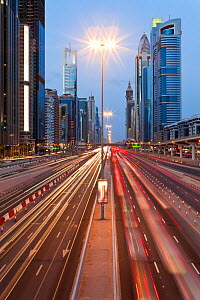 Sheikh Zayed Rd at dusk with traffic and new high rise buildings along Dubai's main road, United Arab Emirates 2011 - Gavin Hellier