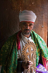 Church Priest holding a Lalibela Cross, Lalibela and its rock-hewn Churches rank among the greatest religio-historical sites not only in Africa, but in the Christian world, Lalibela, Ethiopia 2005. Mo...  -  Gavin Hellier