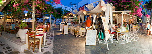 Panoramic view of restaurants in the old town at night, Mykonos (Hora), Cyclades Islands, Greece, 2010  -  Gavin Hellier
