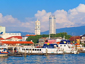 Boats in harbour and Georgetown city skyline with Victoria Memorial Clock Tower, Penang, Pulau Pinang, Malaysia 2008  -  Gavin Hellier