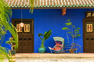 Detail of Trishaws lined up against a blue painted wall in Chinatown district, Georgetown, Penang (Pulau Pipang) Malaysia 2008  -  Gavin Hellier