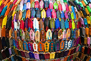Wide angle view of soft leather Moroccan slippers in the Souk, Medina, Marrakech, Morocco, 2011  -  Gavin Hellier