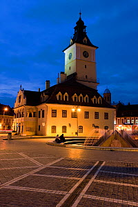 Piata Sfatului, the centre of medieval Brasov, the Council House (Casa Sfatului), from 1420 topped by a Trumpeter's Tower, this old city hall today houses the Brasov Historical Museum - illuminated at...  -  Gavin Hellier