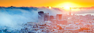 Panoramic view of the foggy skyline of San Francisco at sunrise, California, USA 2011  -  Gavin Hellier