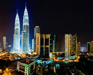 Elevated night view of the Petronas Twin Towers, illuminated at night, Kuala Lumpur, Malaysia, 2012. No release available.  -  Gavin Hellier