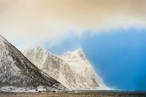 Snow squall falling on coastal mountains. Tortenberget across Ballesvika, Senja, Norway, February 2012.  -  Niall Benvie