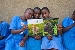 Students reading Ranger Rick, a children's nature magazine. Kasiisi School funded by the Kasiisi School Project, just outside of Kibale National Park, Uganda, August 2011  -  Suzi Eszterhas