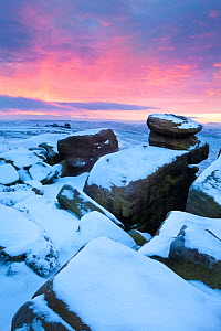 Sunrise over White Tor on Derwent Edge, looking on towards the Wheel Stones. Peak District National Park, January.  -  Alex Hyde