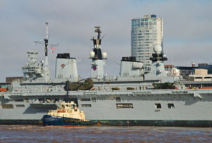 Tug assisting 'HMS Illustrious' as she arrives in Liverpool, River Mersey, England, February 2013. For editorial use only. - Norma Brazendale