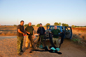 Sovereign Base Area Police at Deleleia with seized illegal trapping equipment from dawn raids, Cyprus, September 2011  -  David Tipling