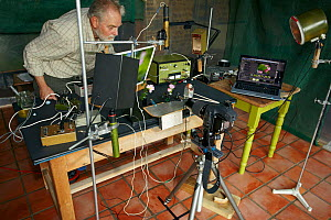 Stephen Dalton's insect flight photography set-up.~Apart from the camera and computer, all the equipment is home made, dating back to the 1970's Quite clearly it's not portable and can only be used in...  -  Stephen Dalton