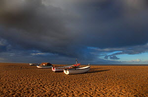 Boats on Cley Beach with stormy clouds above, UK November 2012  -  Ernie  Janes