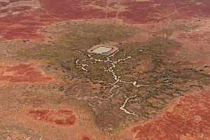 Aerial of Dam in the Strzelecki Desert for cattle just out of Birdsville belonging to Pandie Pandie Station. Dam water comes from bore water from the Great Artesian Basin, South Australia, June 2011  -  Jurgen Freund