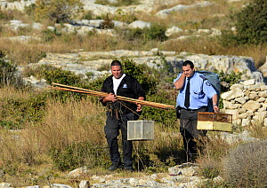 ALE (Administrative Law Enforcement) Police with confiscated turtle doves (Streptopelia turtur) and equipment from dove trapping area, Malta, during Birdlife Malta Springwatch Camp, April 2013  -  David Tipling