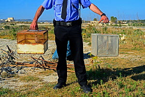 ALE (Administrative Law Enforcement) police with confiscated turtle doves (Streptopelia turtur) and equipment from dove trapping area, during BirdLife Malta Springwatch Camp, Malta, April 2013. No rel...  -  David Tipling