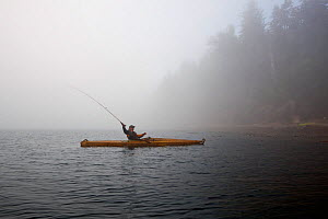 Fly fishing from a kayak in the Straits of Juan De Fuca near Sail and Seal Rocks. Washington, USA, August 2012. - Kirkendall-Spring