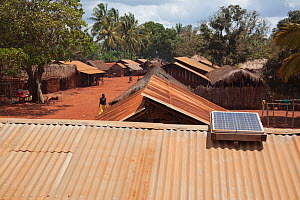 Solar panel on a corrugated iron rooftop in village, Miono region, Tanzania.  -  Tom Gilks