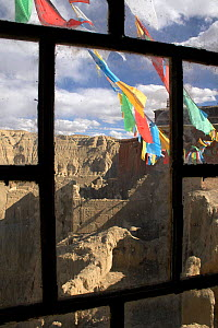 Buddhist prayer flags outside window frame at Tsaparang (sometimes known as the mythical Shangri-la) was the capital of the ancient kingdom of Guge in the Garuda Valley, Ngari Prefecture, Western Tibe...  -  Ben Lascelles