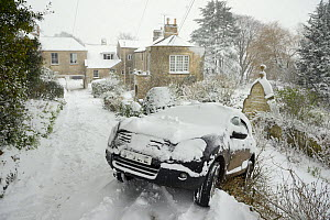Car that has slid off driveway after losing traction on deep snow, Wiltshire, UK, January 2013  -  Nick Upton
