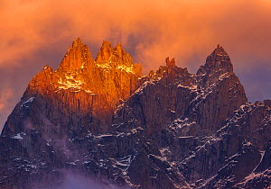 Mountain Peaks at dusk, from left to right, Aiguille de Blaitiere, Aiguille de Cigeaux, and Aiguille du Fou. Chamonix, France, September 2012  -  Andy Trowbridge