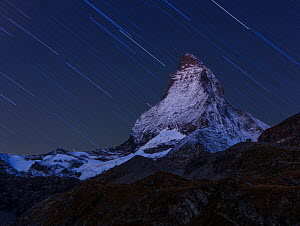 RF- Matterhorn (height 4,478m) at night, with star trail, taken from Schwarzsee. Zermatt, Switzerland, September 2012. Composite image. (This image may be licensed either as rights managed or royalty...  -  Andy Trowbridge