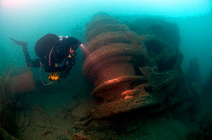Diver inspecting forward winch on the 'SS War knight' sunk by collision, fire, mine and gunfire during the 1st World War. Freshwater Bay. Isle of Wight, May 2010  -  Michael Pitts