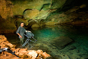 Cameraman Barrie Britton filming blind cave fish in limestone cave, Lac Tsimanampetsotsa National Park, Madagascar. Photograph taken on location during filming for BBC 'Wild Madagascar' Series, Febru...  -  Barrie Britton