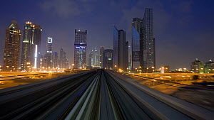 Timelapse looking out of the front of a train on the elevated Dubai Metro System, Dubai, United Arab Emirates, 2011.  -  Gavin Hellier