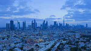 Timelapse from day to night looking towards the Dubai skyline on Sheikh Zayed Road, including the Burj Khalifa, Dubai, United Arab Emirates, 2011.  -  Gavin Hellier