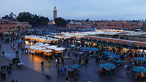 Timelapse from day to night looking over Djemaa el-Fna market, Marrakech, Morocco, 2011.  -  Gavin Hellier