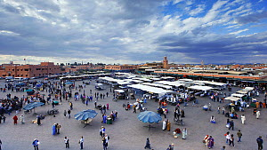 Timelapse from day to night with clouds forming, looking over Djemaa el-Fna market, Marrakech, Morocco, 2011. - Gavin Hellier