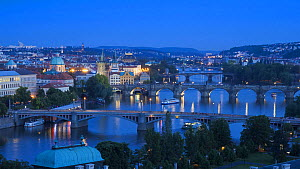 Timelapse from day to night of boats moving on the River Vitava, with an elevated view over the Charles Bridge, Prague, Czech Republic, 2011. - Gavin Hellier