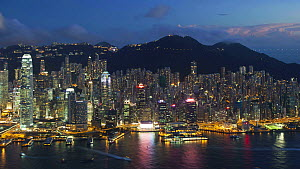 Timelapse from day to night overlooking Hong Kong Island towards Victoria Peak, Victoria Harbour and the Financial District, Hong Kong, China, 2011. - Gavin Hellier