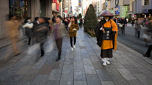 Timelapse of a Shinto priest seeking donations on the main shopping street in Ginza, Tokyo, Honshu, Japan, 2011.  -  Gavin Hellier