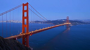 Timelapse from day to night of vehicles driving across the Golden Gate Bridge, San Francisco, California, USA, 2011.  -  Gavin Hellier