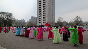 Women in traditional dress dancing during street celebrations on the 100th anniversay of the birth of President Kim Il Sung, Pyongyang, Democratic Peoples' Republic of Korea (DPRK), April 15th 2012.  -  Gavin Hellier