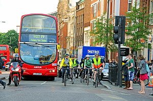 Commuter cyclists and bus in rush hour traffic, Angel, London Borough of Islington, England, UK, May 2009 - Pat  Tuson