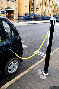 Electric car recharging at an Elektrobay Electric Vehicle Recharging Site in an urban street, London Borough of Islington, England UK  -  Pat  Tuson