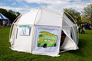 London Permaculture Network on green bus with Transition as it's destination printed on side of tent at  London Green Fair (previously Camden Green Fair) England UK, June 2012 - Pat  Tuson