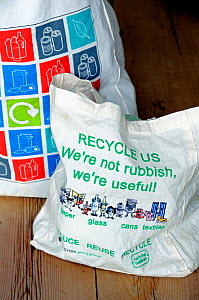 Reusable cotton bags on kitchen table, with images and text promoting 'reduce reuse recycle' Holloway, London Borough of Islington  -  Pat  Tuson
